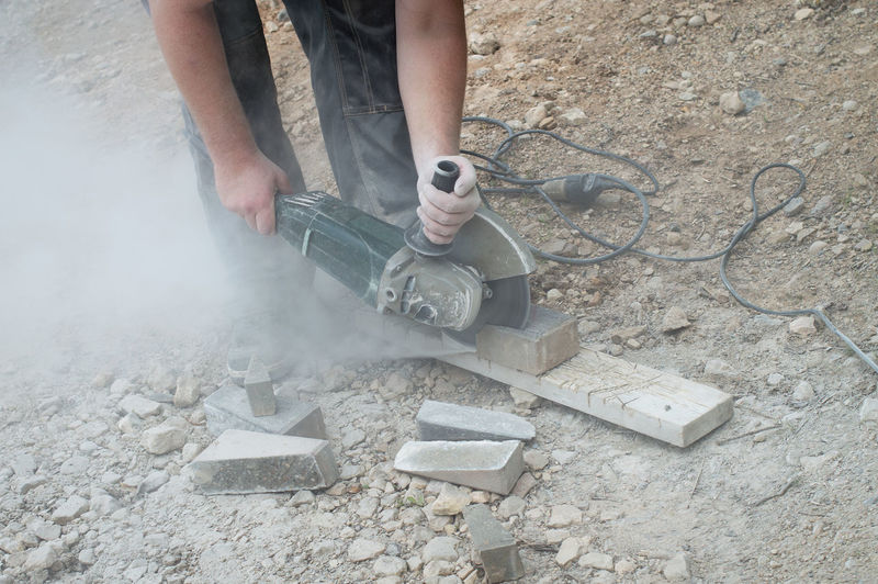 High angle view of man working on concrete