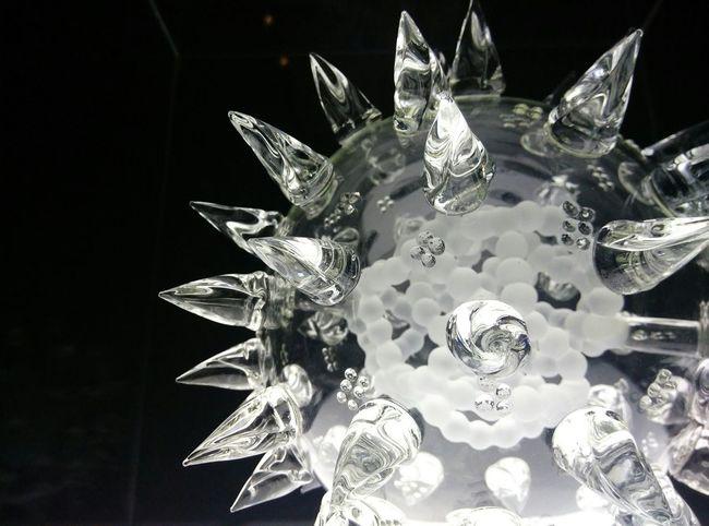 Luke Jerram's glass microbiology in Da Vinci : Shaping the future - this is a futurustic virus sculpture