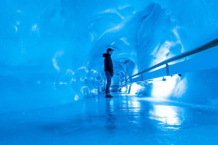 Adventure Balance Blue Cold Temperature Day Frozen Full Length Fun Glacier Cave Healthy Lifestyle Ice Rink Ice-skating Leisure Activity Lifestyles Men Motion One Man Only One Person Outdoors Skill  Sport Swimming Pool Vacations Winter Winter Sport