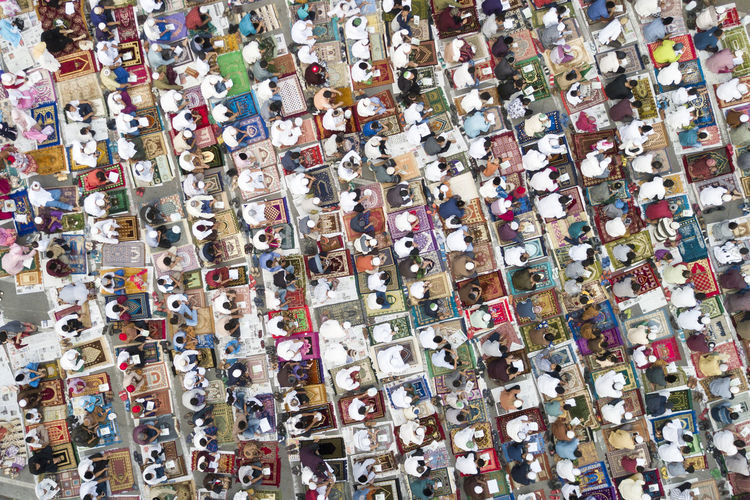 Full Frame Shot Of People Praying In City
