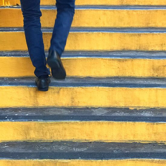 Low Section Human Leg Lifestyles Outdoors One Person Day Yellow Stairs Walking Up The Stairs Rear View Human Body Part Pedestrian One Man Only City Urban Lifestyle Smart Casual Blue And Yellow Steps Close Up Paint The Town Yellow The Week On EyeEm Be. Ready.