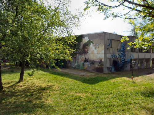 La scuola Building Exterior Buildings & Sky Colors Day Graffiti Art Graffiti Wall Grass Green Color Growth Murales Muralesart Nature Outdoors Plant RePicture Growth Showcase April Spring Into Spring Tree Urban Spring Fever The Graphic City