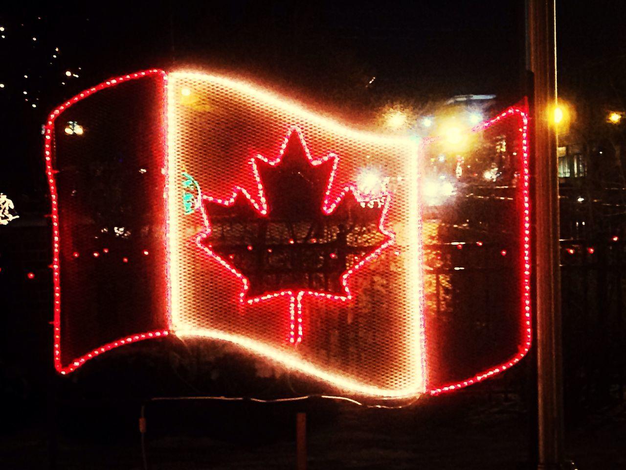 Close-Up Of Illuminated Neon Canadian Flag Sign At Night