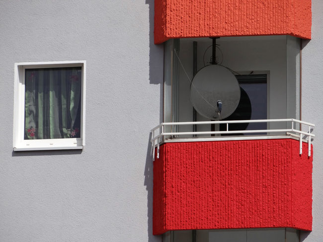Close-up of a window next to a red balcony Architecture Balcony Built Structure Close-up Closed Colorful Colors Curtain Day Home Home Is Where The Art Is House House Front Living No People Outdoors Red Sattelite Dish Window