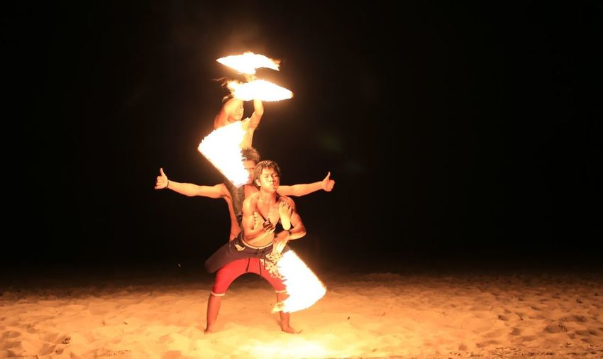 Night fire batons show Burning Celebration Close-up Dancing Diwali Diya - Oil Lamp Fire Batons Fire Dancing Show Flame Heat - Temperature Human Body Part Illuminated Indoors  Night One Person People Performance Real People Show Fire Batons Showbatons