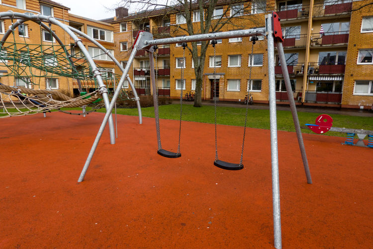 View of empty playground against buildings