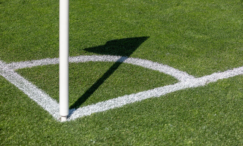 Shadow of woman on soccer field