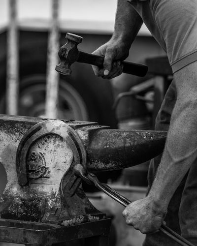 Horshoe with anvil and hammer Strength Outdoors Real People Monochrome Horseshoe Blackandwhite Blacksmith  One Person Occupation Working Industry Adult Men Human Body Part Metal Equipment Hand Working Industry Adult Focus On Foreground