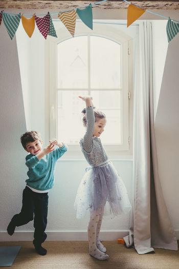 Girl and boy playing at home