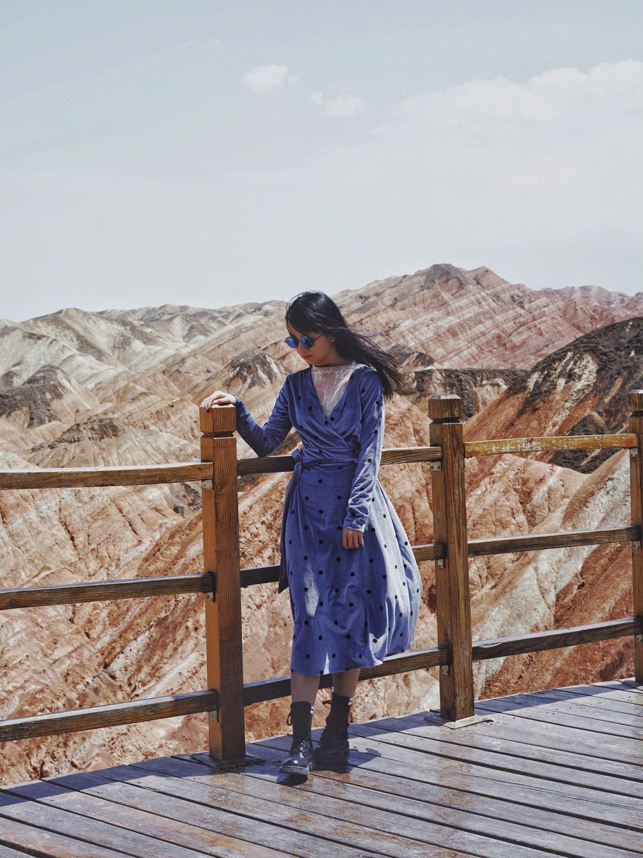 Full length of woman standing on bridge against sky