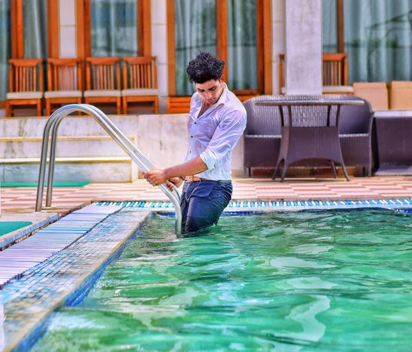 semi dude EyeEm Best Shots EyeEmNewHere Swimming Pool Full Length Modern Men Handsome Happiness Business Motion Healthy Lifestyle Poolside Infinity Pool Water Slide Splashing My Best Photo
