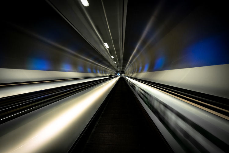 Rotterdam Architecture Blurred Motion Built Structure Ceiling Diminishing Perspective Direction Futuristic Illuminated Indoors  Light - Natural Phenomenon Lighting Equipment Long Exposure Modern Motion Moving Walkway  No People Railing Speed Subway The Way Forward Transportation Travel vanishing point Wilhelminaplein