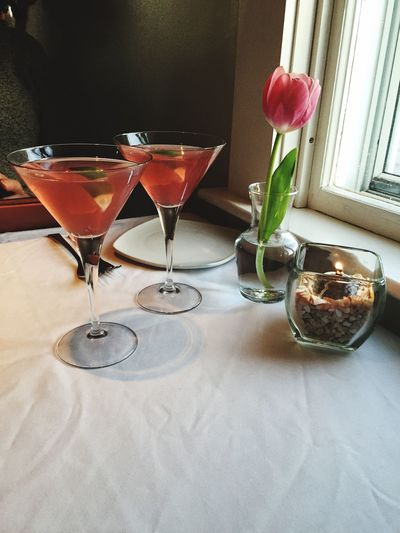 Cocktail In Martini Glasses On Table At Restaurant