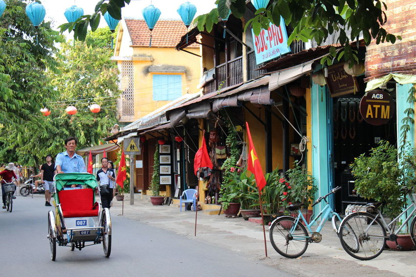 Hoi An Cyclo Heritage Vietnam Flag Street City Street Bicycle Transportation City Life Outdoors City Day People Architecture An Eye For Travel