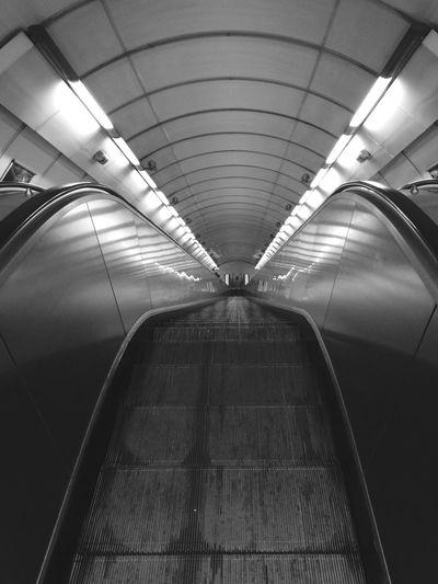 Low angle view of illuminated underground walkway