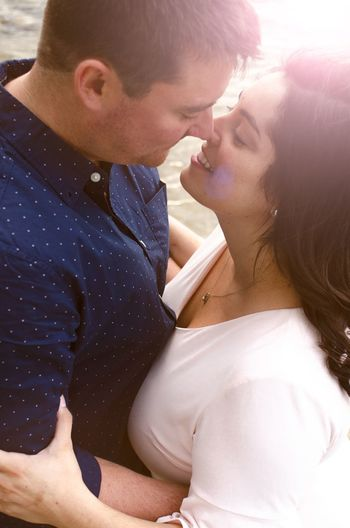 Midsection of couple kissing