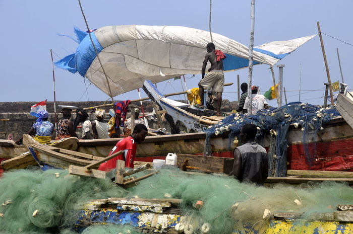 Africa Beach Canoe Cultural Heritage Developing Country Fish Fisherman Fishing Fishing Boat Fishing Net Ghana Ghanaian Pirogue Poor  Poverty Sail Selling Fish Travel Travel Photography Tropical Climate tradition, traditional, men at work People Of The Oceans