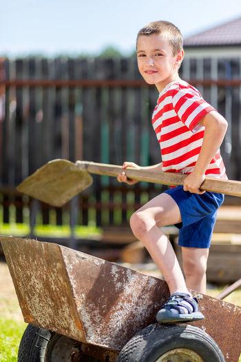 Portrait of boy smiling water