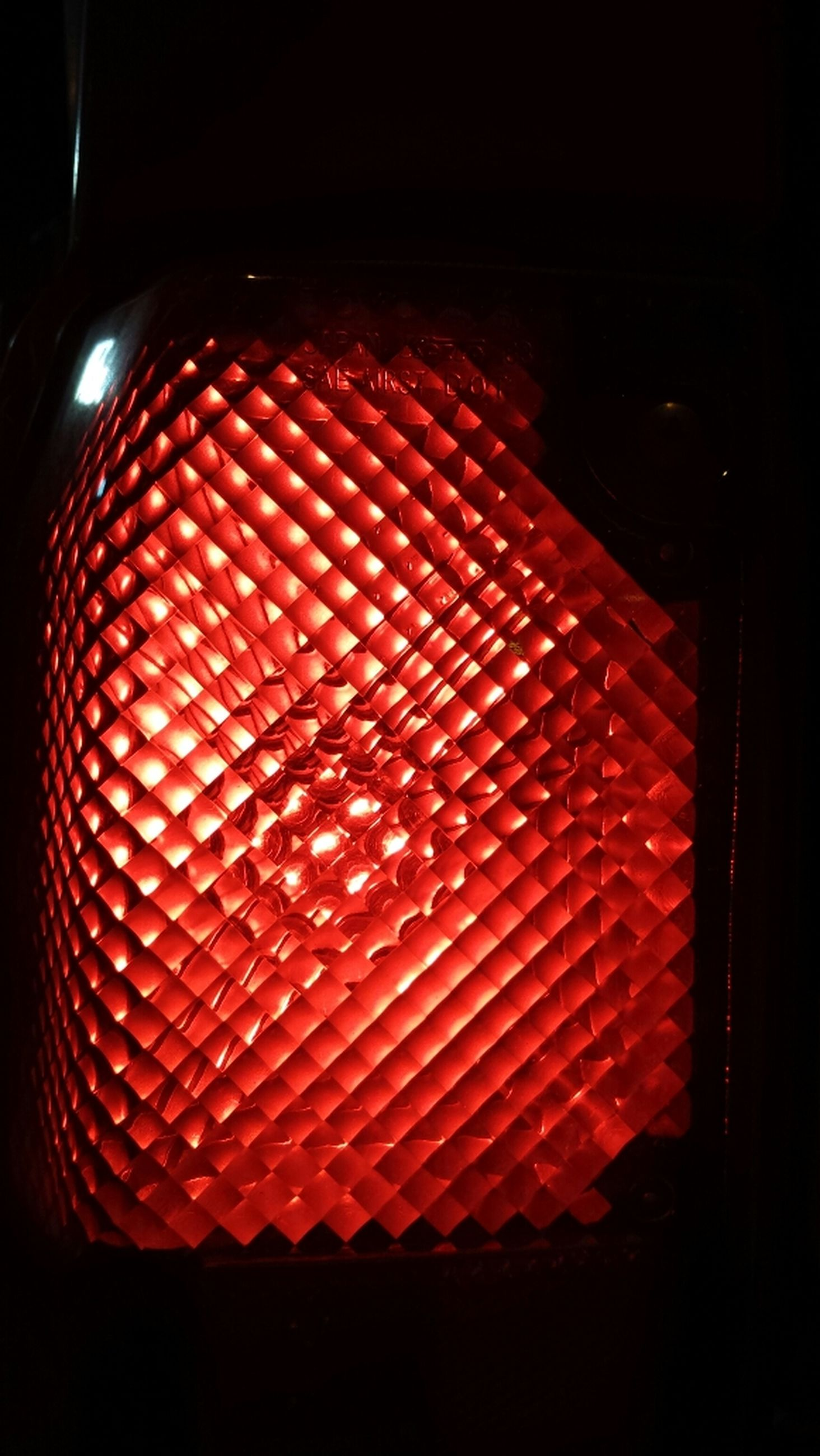 indoors, illuminated, close-up, red, glass - material, pattern, dark, still life, no people, window, night, lighting equipment, hanging, home interior, design, multi colored, transparent, shape, in a row, light - natural phenomenon