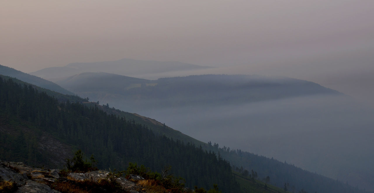 View Of Mountain Range In Foggy Weather