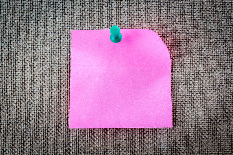 Reminder sticky note on cork board, empty space for text Adhesive Note Blank Bulletin Board Close-up Communication Copy Space Empty Indoors  Message No People Note Paper Pink Color Purple Reminder Single Object Still Life Straight Pin Table Textile Textured  Thumbtack
