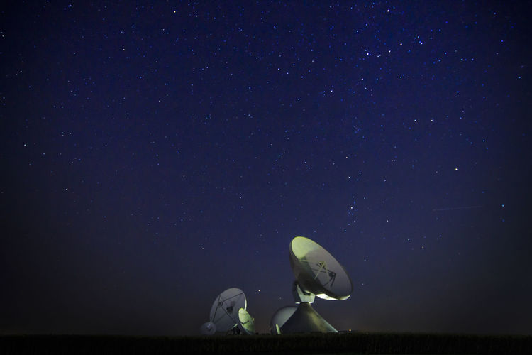Satellite Against Star Field At Night