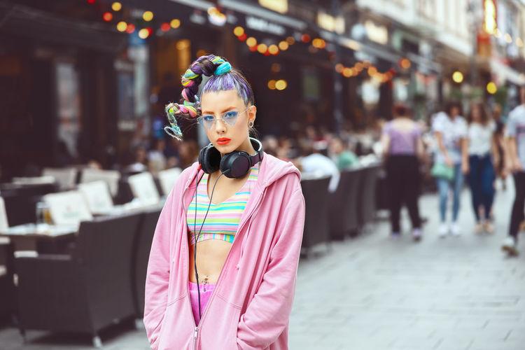 Portrait of teenage girl standing on street