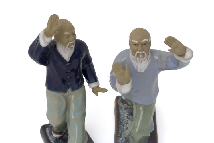 seniors practising tai chi - two figurines over white with soft shadow Beard China Chinese Chinese Culture Exercising Figurine  Healthy Lifestyle Male Likeness Men No People Qi Gong Sculpture Senior Men Sports Training Sportsman Studio Shot Tai Chi Tai Chi Chuan Taiji Taijiquan Three Quarter Length Two Objects White Background Yingyang Zen