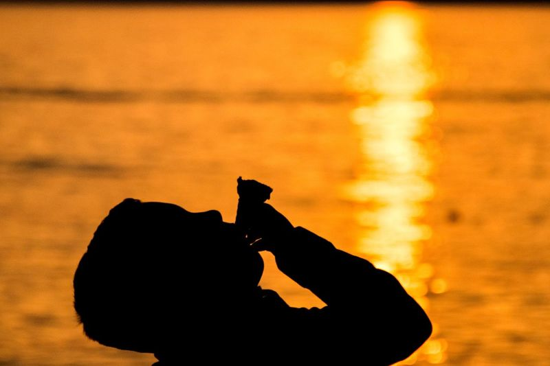Ways Of Seeing Icecream🍦 Silhouette Sunset Orange Color One Person Real People Nature Leisure Activity Human Hand Human Body Part Beauty In Nature