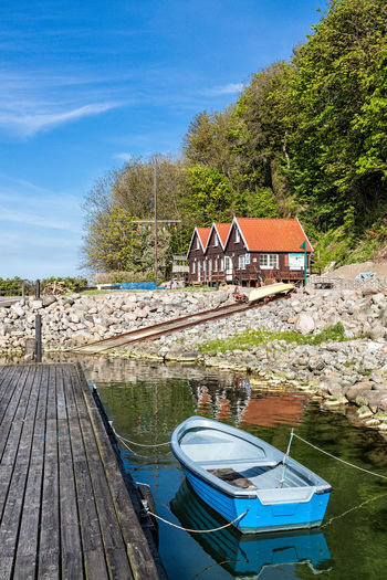 Port in Lohme, Germany. Architecture Baltic Sea Blue Boat Building Building Exterior Coast Day Harbor Holiday Lohme Nature Nautical Vessel No People Outdoors Port Reflection Ruegen Island Shore Sky Tourism Travel Tree Vacation Water