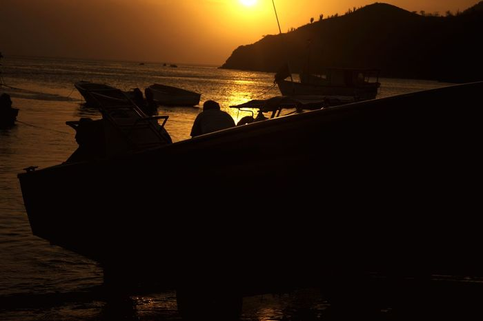 Water Wave Sea Sunset Beach Silhouette Sky Horizon Over Water Boat Erupting Rocky Coastline Calm Surf Lava Coastline Volcanic Activity Moored Groyne Active Volcano Kilauea Rock Formation Rugged Seascape Volcano Volcanic Rock