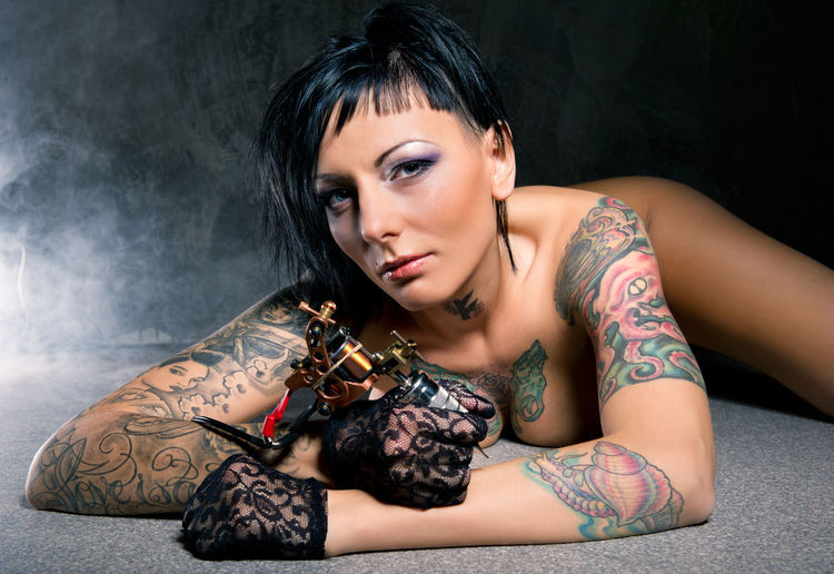 Beautiful woman with many tattoos posing indoors Looking At Camera Slim Tattooed Woman Adult Beautiful Woman Brunnette Caucasian Erotic_art Erotic_model Erotic_photo Lying Down Naked_art Nude_model One Person Seductive Woman Sexygirl Sexywomen Studio Shot Tattoed Girl  Tattoo Machine Tattoos Women Young Adult Young Women