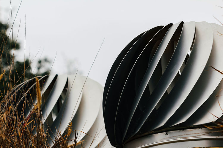No People Close-up Nature Sky Day Plant Pattern Metal Outdoors Focus On Foreground Steel Clear Sky Stack Grass Field Still Life Fan Glass - Material Selective Focus Alloy