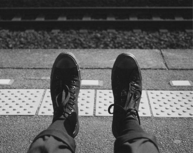 Low section of man at railroad station platform