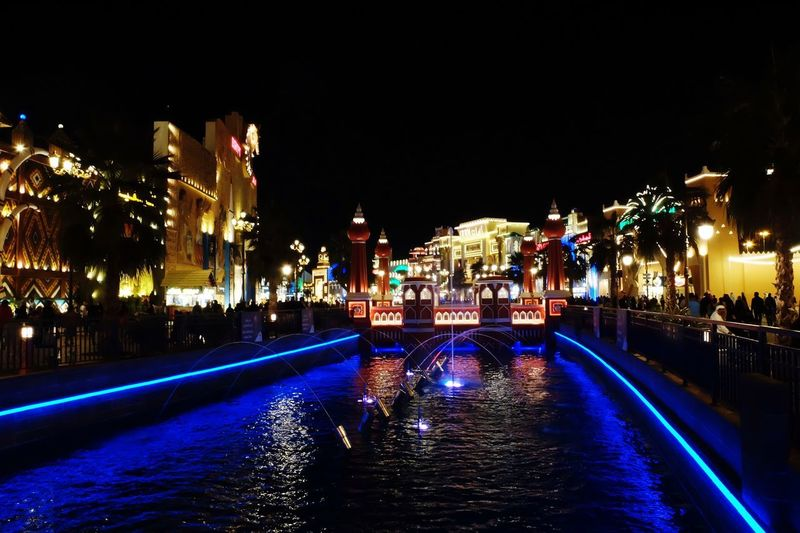Global Village Dubai Global Village Night Illuminated Architecture City Building Exterior Built Structure Water Street Clear Sky Sky Travel Destinations Cityscape Decoration No People Outdoors Nature Glowing Reflection Lighting Equipment Building Light - Natural Phenomenon Architecture Lighting Equipment City City Life Incidental People Reflection Nature