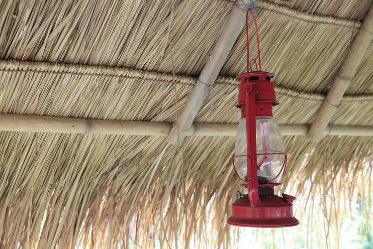 Close-up of red pipe hanging from ceiling