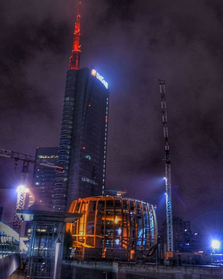 Night City Illuminated Skyscraper Travel Urban Skyline City Life Architecture No People Modern Business Finance And Industry Luminosity Sky Outdoors Milano Italy Italy Holidays Aliens Alien Bulding Alien Landscape Future Vision Futuristic Futuristic Architecture Nightphotography Night Sky Close Up Technology