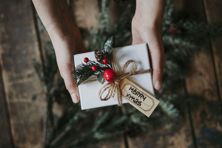 One Person Holding Focus On Foreground MerryChristmas Merry Christmas! Celebration Christmas Real People Christmas Ornament Lifestyles Gift Present Xmas Giving Christmas Christmas Decoration