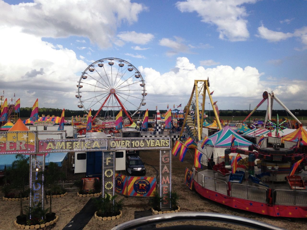 amusement park, arts culture and entertainment, cloud - sky, sky, ferris wheel, amusement park ride, day, outdoors, no people, carousel