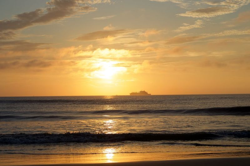Sunrise Sunset Sky Water Sea Beauty In Nature Scenics - Nature Tranquility Beach Cloud - Sky Idyllic Nature Horizon Over Water Reflection Orange Color Sunlight Land No People Sun Horizon Tranquil Scene
