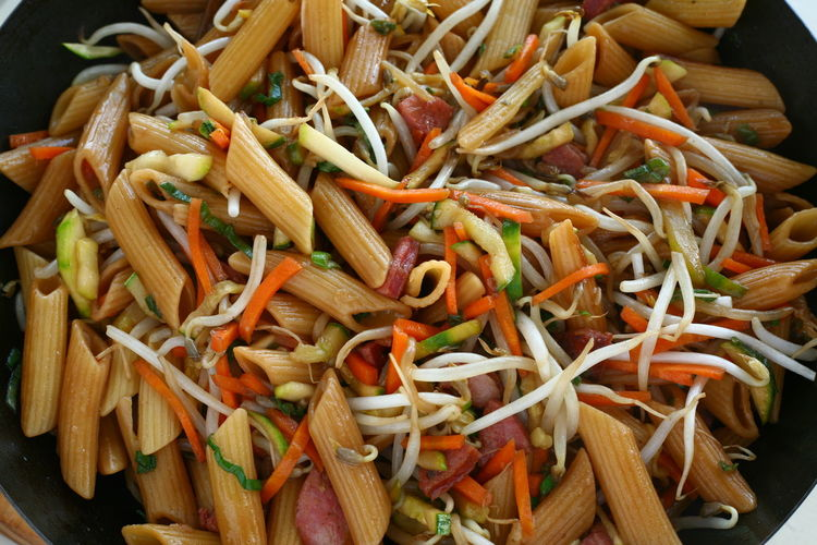 Asian Style Penne Rigate Asian Style Close-up Day Food Food And Drink Freshness Healthy Eating Indoors  No People Past Penne Italy Penne Rigate Sauteed Sautéed Pasta Soy Sauce Soy Sauce Pasta Wok Wooden Spoon