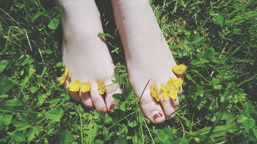 Flowers on human legs