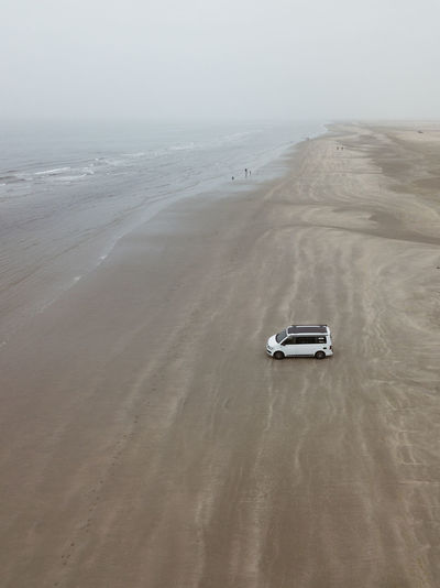 Beach Beauty In Nature Day High Angle View Horizon Horizon Over Water Land Land Vehicle Mode Of Transportation Motion Motor Vehicle Nature No People Outdoors Sand Scenics - Nature Sea Sky Tranquility Transportation Water