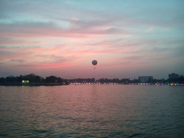 Beauty In Nature City Cloud - Sky Hot Air Balloon Kankaria Lake Lake Outdoors Pink Color Scenics Sky Sunset Vacations Water Waterfront