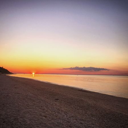 Sunset Sea Beauty In Nature Scenics Orange Color Beach Nature Tranquility Tranquil Scene Sun Horizon Over Water Water Sky Idyllic No People Sand Silhouette Outdoors Clear Sky End Of The Day