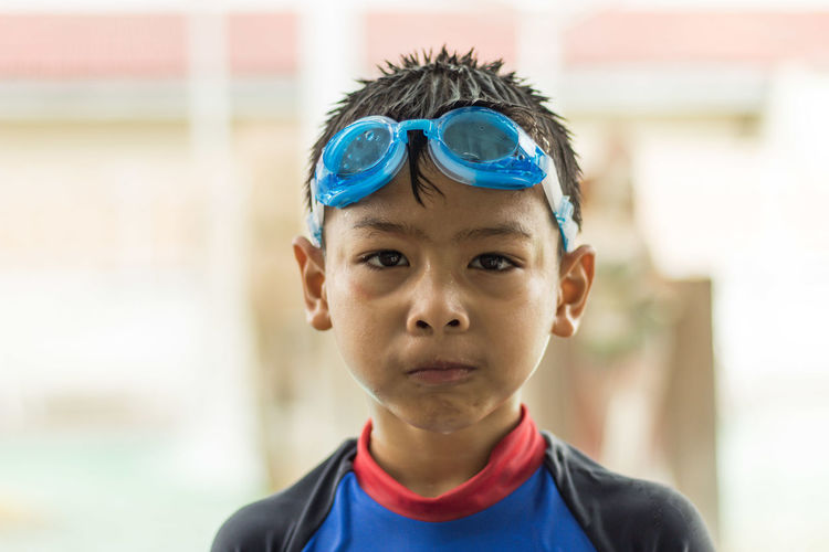 Portrait of boy wearing swimming goggles