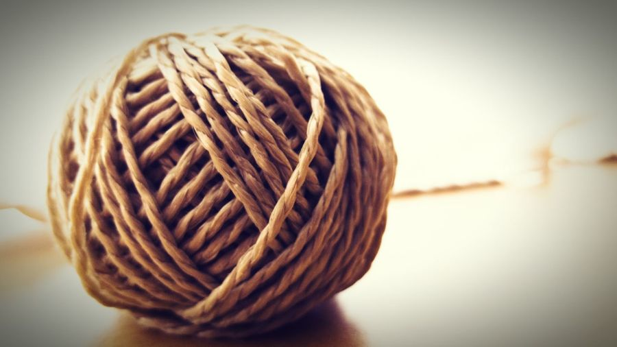 Close-up of rope ball on table