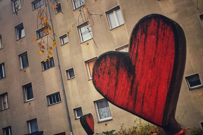 the heart of neukölln Art ArtWork Building Exterior Window Built Structure Red Low Angle View Day No People Outdoors City Heart Love Love ♥ Emotions Strassenfilm Berlin Photography Neukölln Concept Berliner Ansichten Peaceful