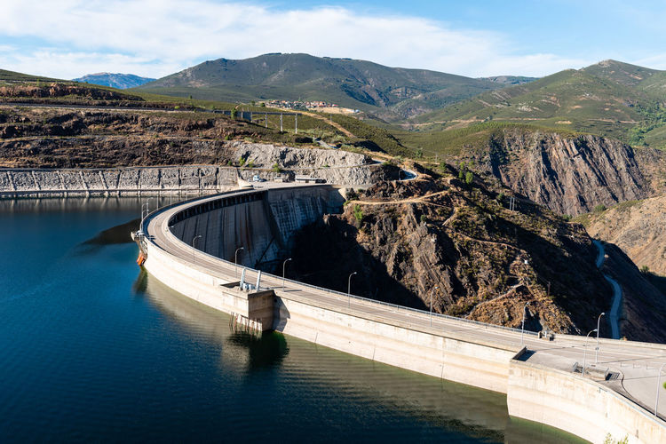The atazar reservoir and dam in the mountain range of madrid.