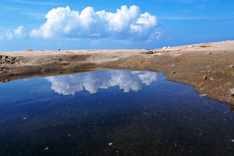 Reflection from water skin make a mirror of Nature Water Sky Cloud - Sky Land Beauty In Nature Scenics - Nature Nature Sea Beach Day No People Blue Sand Outdoors Reflection Tranquility Tranquil Scene